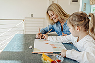 Mature woman and girl at home drawing together - JOSF00888