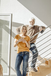 Portrait of smiling couple at home - JOSF00918