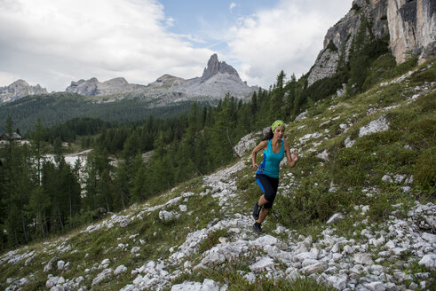 Italy, Dolomites, Veneto, trail runner at Federa Lake - ZOCF00299