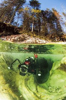 Austria, Upper Austria, Lake Attersee, Weissenbach, river diving - GNF01391