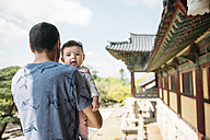 South Korea, Gyeongju, man traveling with a baby girl in Bulguksa Temple - GEMF01616