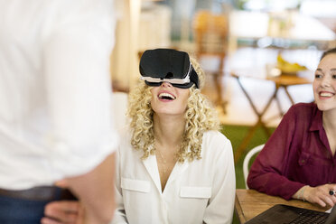 Blond woman trying out VR goggles at a workshop - PESF00561