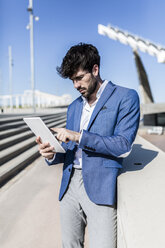 Young businessman using tablet outdoors - GIOF02606