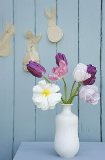 Flowers in a vase and self-made Easter decoration on wall - GISF00285