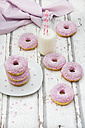 Doughnuts with pink icing and sugar granules and a bottle of milk - LVF06111