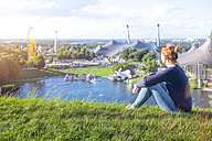 Germany, Bavaria, Munich, Woman looking over the Olympic Area - MMAF00111
