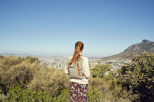 South Africa, Cape Town, Signal Hill, young woman overlooking the city - SRYF00515