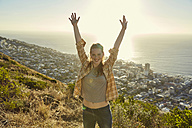 South Africa, Cape Town, Signal Hill, portrait of happy young woman above the city - SRYF00572