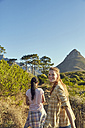 South Africa, Cape Town, Signal Hill, two young women hiking - SRYF00575