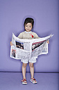 Portrait of smiling little girl with newspaper - FS00898