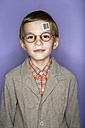 Portrait of boy with bar code label on his forehead - FSF00910
