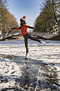 Woman ice skating on canal - MFF03508