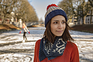Close-up of woman ice skating on canal - MFF03511