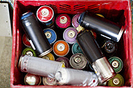 Spray paint cans in plastic crate - ZEF13692