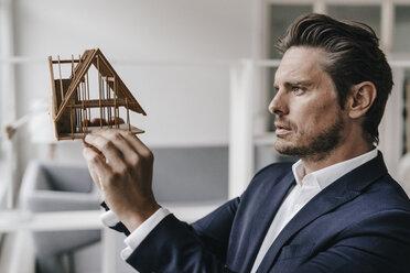 Architect examining architectural model - KNSF01263