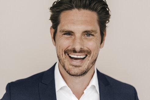 Portrait of laughing businessman - KNSF01269