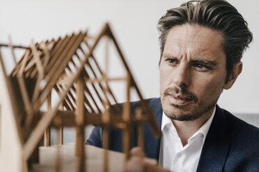 Architect examining architectural model - KNSF01272