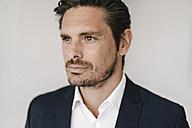 Portrait of serious businessman - KNSF01320