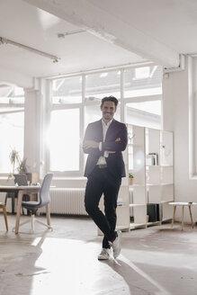 Portrait of confident businessman in office - KNSF01329