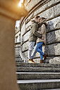 Germany, Potsdam, young couple kissing at Glienicke Bridge - ANHF00029