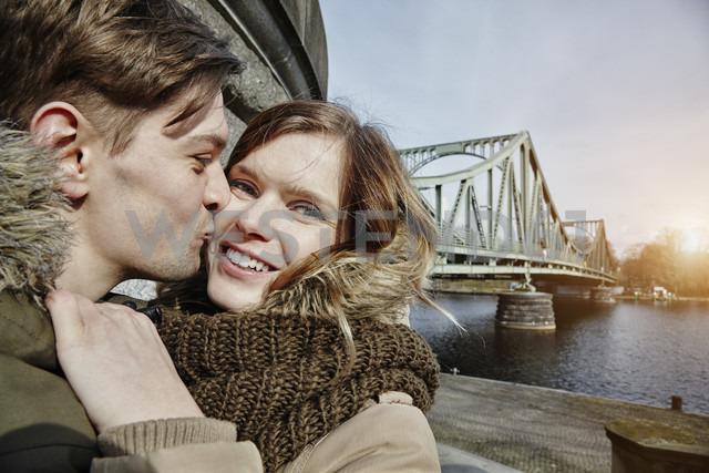 Germany, Potsdam, young couple kissing at Glienicke Bridge - ANHF00032