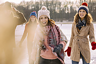 Portrait of happy friends outdoors in winter - MFF03534