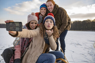 Friends taking a selfie on frozen lake - MFF03555