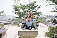 South Korea, Seoul, Father and baby girl visiting Changdeokgung Palace and Huwon - GEMF01634