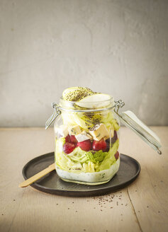 Preserving jar of iceberg salad with grapes, apple, blue cheese and chia seeds - KSWF01809