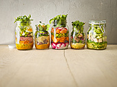 Row of five preserving jars with various salads - KSWF01815