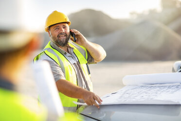 Quarry worker on site talking on the phone - ZEF13718