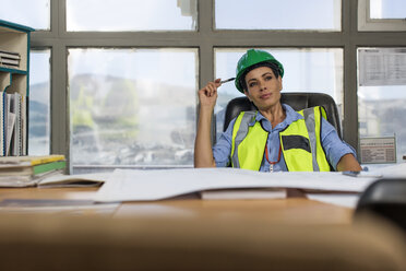 Female worker sitting in site office of quarry - ZEF13751