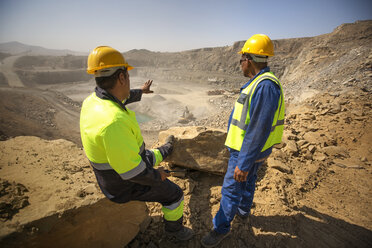 Two quarry workers looking over quarry - ZEF13772