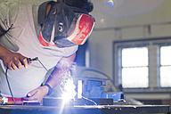 Mechanic welding in car workshop - ZEF13790