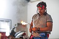 Mechanic welding in car workshop - ZEF13796