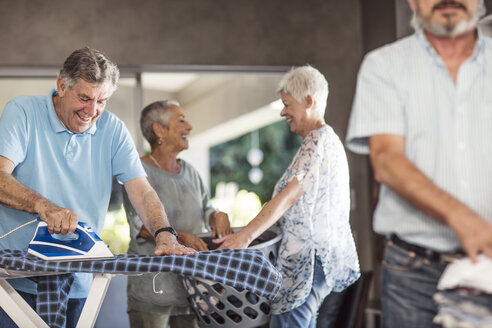 Seniors ironing clothes together - ZEF13826