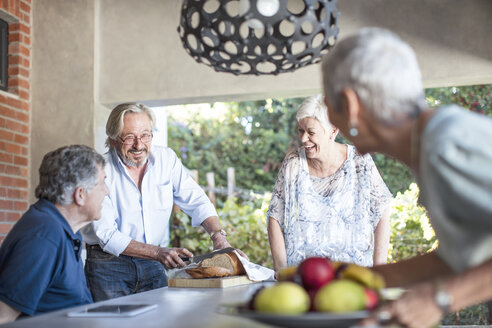 Two happy senior couples together on terrace - ZEF13835