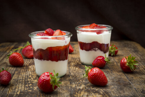 Two glasses of Greek yogurt with strawberries on wood - LVF06138