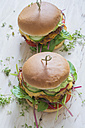 Two veggie burgers with sweet potato patties, avocado dip, cheese and vegetables - ODF01510