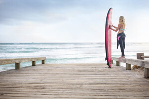 Woman at the ocean with surfboard - ZEF13857