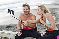 Couple having fun on the beach taking a selfie - ZEF13866