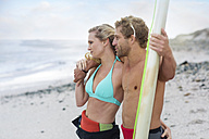 Couple on the beach with surfboard - ZEF13869