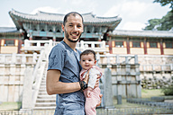 South Korea, Gyeongju, father traveling with a baby girl in Bulguksa Temple - GEMF01644
