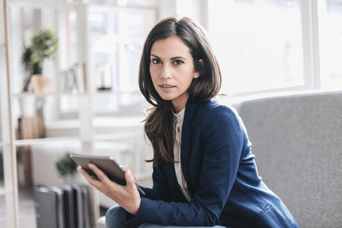 Portrait of businesswoman with tablet on couch - JOSF00960