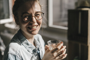 Portrait of happy young woman with glasses - KNSF01453