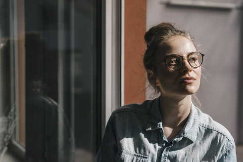 Young woman with glasses thinking - KNSF01465