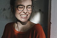 Portrait of happy young woman with glasses - KNSF01495