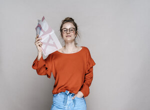 Portrait of young woman holding letter x template - KNSF01507