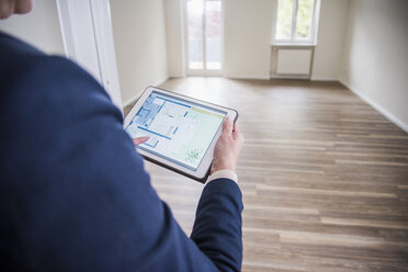 Woman using tablet in smart home - UUF10795