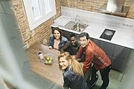 Colleagues having a break in office kitchen - JRFF01328